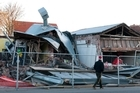 Shops in Opawa collapsed after the Christchurch earthquake. Phil Goff says he believes rebuilding has stalled because insurers are reluctant to pay. Photo / NZPA