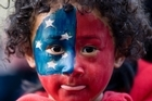 Zavier Smith-Nansen, 4, from Mangere was one of thousands of Samoan rugby fans at Auckland International Airport during the welcome for the Samoa Rugby World Cup team. Photo / Dean Purcell
