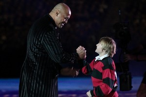 Jonah Lomu greets Ethan during the opening ceremony. Photo / Brett Phibbs