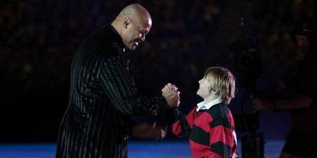Jonah Lomu greets Ethan during the opening ceremony. Photo / Brett Phibbs
