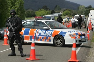 Armed police check vehicles at a roadblock in the Ruatoki Valley during the 2007 Operation eight raids. Photo / Alan Gibson