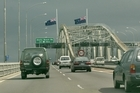 New Zealand flags on the Auckland harbour bridge at half mast in 2002 in memory of the people who died in the Bali bomb blasts. Photo / Brett Phibbs 