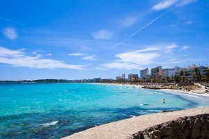 Cala Millor's promenade is lined with benches where Spaniards regularly meet of an afternoon to sit and watch the surf. Photo / Thinkstock