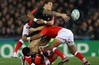 Sonny Bill Williams off-loads during the All Black's Rugby World Cup opener against Tonga. Photo / Getty Images