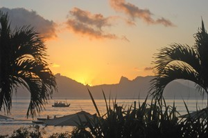 The spectacular view at sunset from the Papeete seafront, home to Les Roulottes. Photo / Sophie Bond