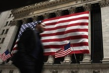 A man walks in front of the New York Stock Exchange in New York City. Sharemarkets in Europe and the US rallied overnight. Photo / AFP