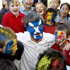 Scotland supporter Gerry Ford is mobbed by school children from Middle School supporting Romania. Photo / Getty Images