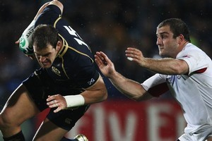 Scotland's Rory Lamont evades the tackle of Georgia's Jaba Bregvadze. Photo / Getty Images