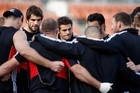 Richie McCaw stands in the team huddle after being ruled out of the team named to play Japan in Hamilton during the Rugby World Cup. Photo / Getty Images