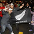 Fans celebrate after the All Blacks win the first game of the Rugby World Cup. Photo / Steven McNicholl