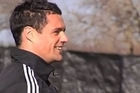 A stiff back will mean Dan Carter will not play in Friday's match against Japan.