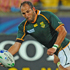 Fourie du Preez of South Africa looks to offload as he is tackled by Mike Phillips of Wales. Photo / Getty Images