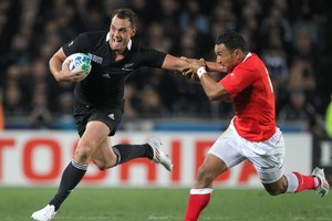 Israel Dagg fends off Tonga's Kurt Morath. Photo / Paul Estcourt