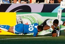 Fiji no.11 Naipolioni Nalaga scored in the second half despite the efforts of Namibian no.19 Rohan Kitshoff. Photo / Christine Cornege