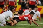 Japan's James Arlidge goes in for his team's first try against France. The Aucklander scored all his side's points, including two tries. Photo / Paul Estcourt