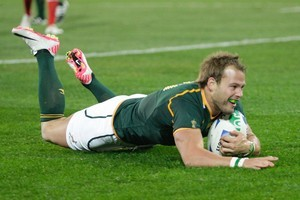 Francois Hougaard, of South Africa, scores the crucial try during last night's defeat of Wales in Wellington. Photo / Mark Mitchell