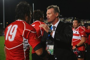 John Kirwan congratulates Itaru Taniguchi of Japan after the game with France on Saturday. Photo / Getty Images