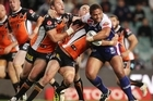 The Warriors' Manu Vatuvei meets tough opposition during last night's semifinal clash with the Wests Tigers in Sydney. Photo / Getty Images