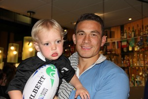 Sonny Bill Williams poses with 2-year-old Maclaren Maber after signing the youngster's ball. Photo / Supplied