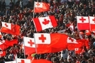 Fans cheer and wave flags during the Tonga v Canada World Cup match. Photo / Sarah Ivey