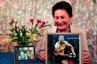 Millie Cooper with pictures of grandson Quade Cooper, in Wallaby colours and with his grandfather. Photo / Malcolm Pullman