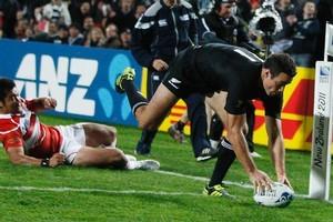 All Black winger Richard Kahui crosses for a try against Japan at Waikato Stadium. Photo / Christine Cornege