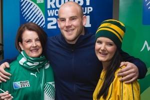 Wallaby hooker Stephen Moore's Irish-born mum, Maureen, wears the green of Ireland while sister Sarah sports Australian gold. Photo / Paul Estcourt