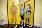 Lucy Lawless shows off the art that she is auctioning for a Greenpeace fundraiser. Photo / Jason Dorday