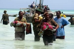 Tanzanian police carry bodies of children from the sea in Zanzibar, Tanzania, Saturday Sept 10, 2011. Photo / AP