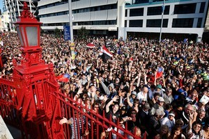 Huge crowds assembled on Quay Street in central Auckland as they waited to get into the Cloud on Queens Wharf for the opening of the 2011 Rugby World Cup. Photo / Sarah Ivey
