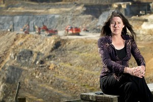 Collette Spalding, spokeswoman for Distressed Residents Action Team, pictured next to the opencast mine near Waihi's mainstreet. Photo / Alan Gibson