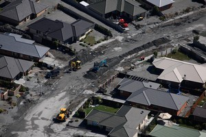 A street in Bexley being cleaned in the aftermath of the Christchurch February quake. Photo / Brett Phibbs