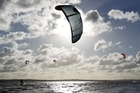 Kite surfers are not complaining about the windy weather. Photo / Steven McNicholl