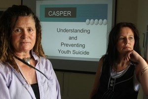 Deb Williams and Maria Bradshaw (right) of Casper yesterday presented the Prime Minister with its latest strategy on tackling suicide. Photo / APN