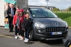 Peugeot GM Grant Smith with one of the vehicles the company provides for Cure Kids. Photo / Supplied