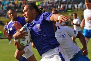 Alesana Tuilagi crosses over for one of his three tries against Namibia. Photo / Getty Images