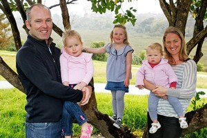 Simon Priddy with (from left to right) daughters Pippa, Olivia and Annabel and wife Jane at the park just down the road from their house. Photo / Steven McNicholl
