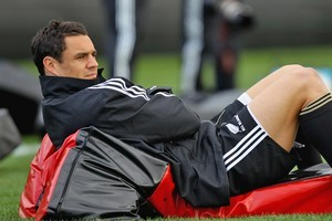 Dan Carter suffered a stiff back in the All Blacks Rugby World Cup- opening match against Tonga. Photo / Getty Images