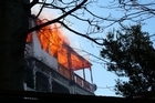Firefighters are battling a blaze at a three story central Wellington apartment. Photo / Adam Errington