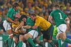Will Genia of the Wallabies is tackled by Donncha O'Callaghan, Paul O'Connell and Mike Ross of Ireland. Photo / Getty Images