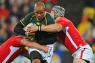 JP Pietersen of South Africa is tackled by Huw Bennett and Dan Lydiate of Wales. Photo / Getty Images