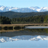 Mountains are reflected in the tranquil waters of Okarito Lagoon. Photo / Supplied