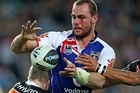 Simon Mannering of the Warriors offloads. Photo / Getty Images