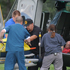 Medics help injured bystanders out of a helicopter into Renown Medical Center following the plane crash. Photo / AP