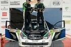 Hayden Paddon celebrates with co-driver John Kennard. Photo - Alan McDonald/macspeedfoto.