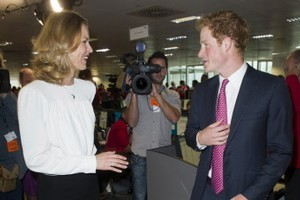 Czech model Eva Herzigova with Prince Harry on the trading floor as he attends BGC Partners' Charity Day in London.