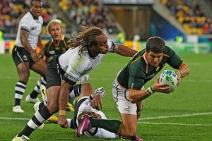 Morne Steyn of the Springboks dives past Gaby Lovobalavu of Fiji to score his team's fourth try. Photo / Getty Images
