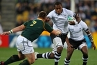 Leone Nakarawa of Fiji is challenged by John Smit of the Springboks. Photo / Getty Images