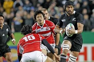 Victor Vito deflects Japanese players. Photo / Christine Cornege