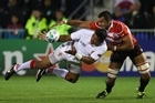 Michael Leitch of Japan tackles Taufa'ao Filise of Tonga. Photo / Getty Images